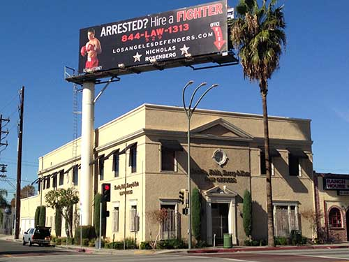 Picture of office of Los Angeles Criminal Defense Attorney with billboard above.