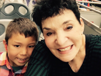 Picture of Dr. Linda Algazi with seven-year-old grandson.
