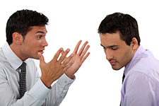 Two business men verbally fighting - Real Estate Litigation Lawyer
