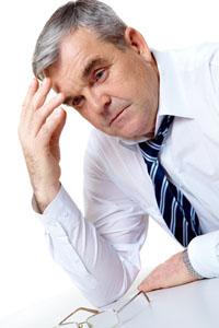 Photo of senior employer thinking about something in isolation
