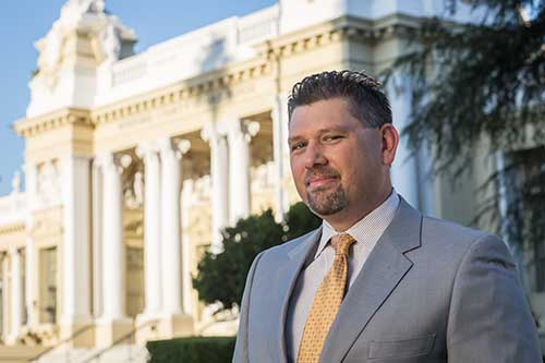 Picture of Riverside Criminal Defense Lawyer Galasso in front of Old Riverside County Court