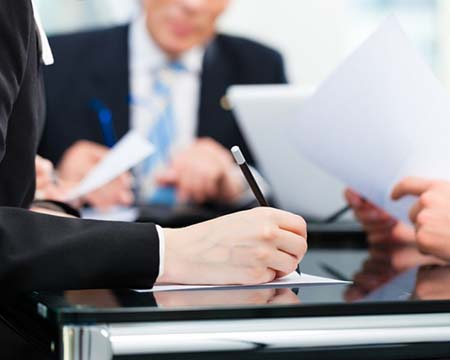 Image of three lawyers at conference table
