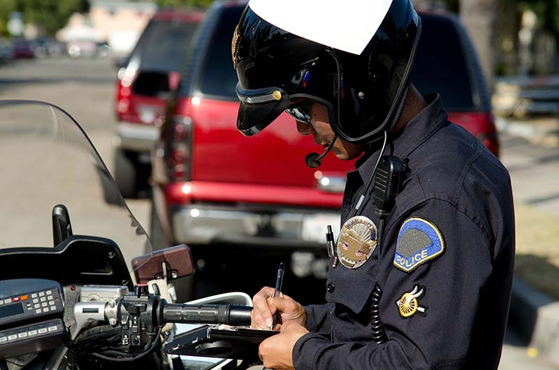 Image of cop writing ticket